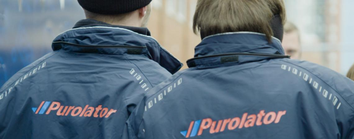 2 people wearing Purolator jackets
